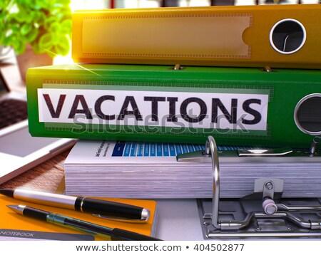 Vacations on Office Folder. Toned Image. Stock photo © tashatuvango