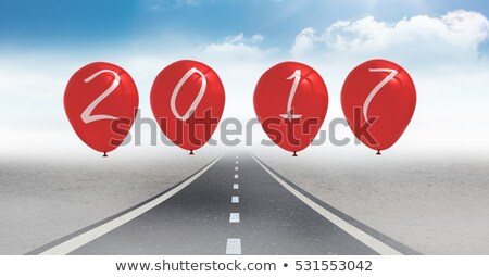 Stock photo: 2017 as balloons against a composite image 3D of road in sky