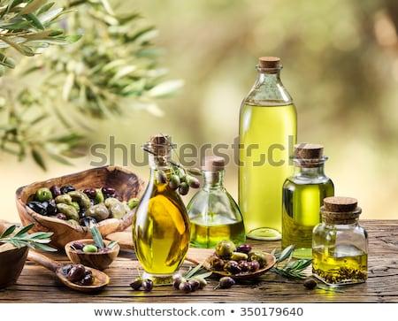 Huile d'olive verre bouteille contenant saine organique Photo stock © Digifoodstock
