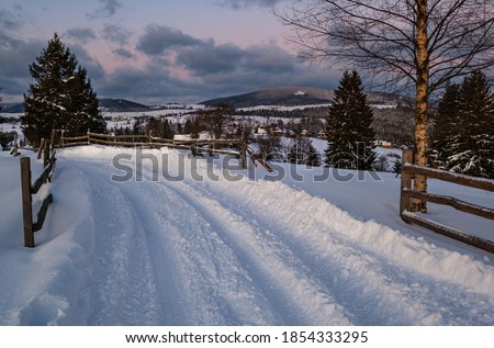 winter dawn in the mountain village stock photo © kotenko