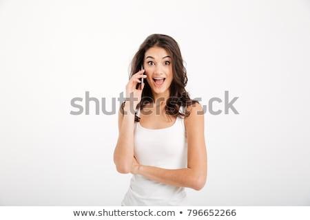 verwonderd · meisje · telefoon · hand · mooie - stockfoto © deandrobot