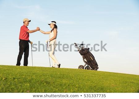 golfen · paar · man · gelukkig · landschap · Blauw - stockfoto © kzenon