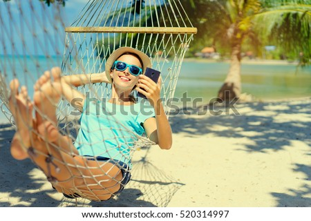 woman with a smartphone on the beach vacation and technology stock photo © artfotodima