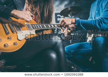 Guitar music teacher helping his student Stock photo © Kzenon