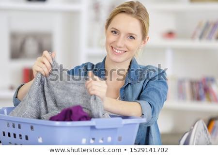 Femme ménagère buanderie maison domestique personnes Photo stock © dolgachov