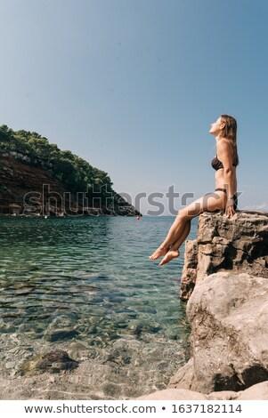 ibiza bikini girl relaxed in clear water beach stock photo © lunamarina