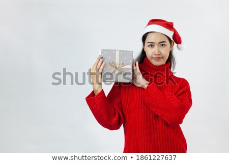 Beautiful young woman in red wearing santa hat Stock photo © Nobilior