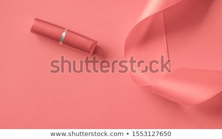 Luxury lipstick and silk ribbon on coral holiday background, mak Stock photo © Anneleven