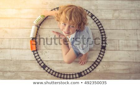 Sevimli küçük erkek oynama ahşap oyun alanı Stok fotoğraf © galitskaya