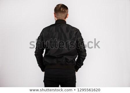 Fiatalember fekete kabát arc divat háttér Stock fotó © Paha_L