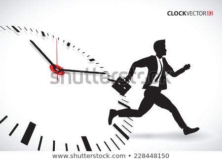 Uomo d'affari eseguire picchiare tempo Foto d'archivio © 4designersart