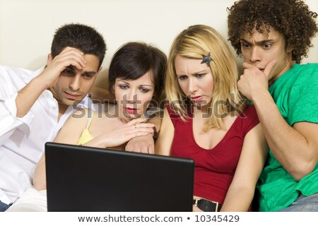 domestic life: group of friends having problems with computers  Stock photo © dacasdo
