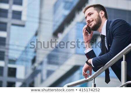üzletember beszél mobiltelefon üzlet telefon város Stock fotó © photography33