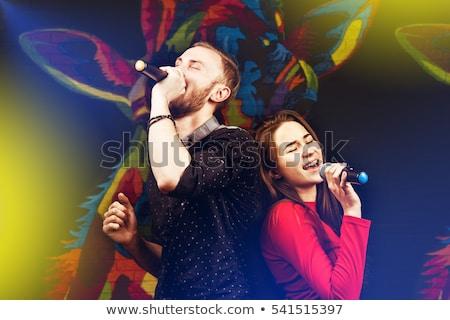 Stock photo: Couple singing karaoke