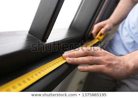 Man measuring wooden frame Stock photo © photography33