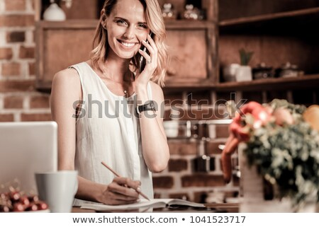 Businesswoman delighted with her phone call Stock photo © photography33