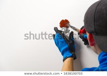 Elettricista elettriche muro lavoro blu Foto d'archivio © photography33