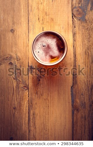 Single beer glass on wooden table Stock photo © shutswis
