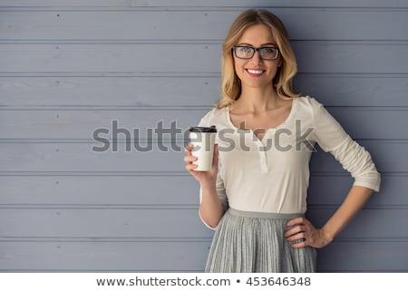 Portré mosolygó nő tart csésze kávé fehér Stock fotó © wavebreak_media