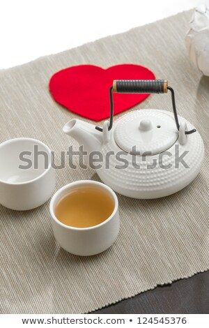 Valentine's day surprice for couple. Romantic tea set with red h Stock photo © HASLOO
