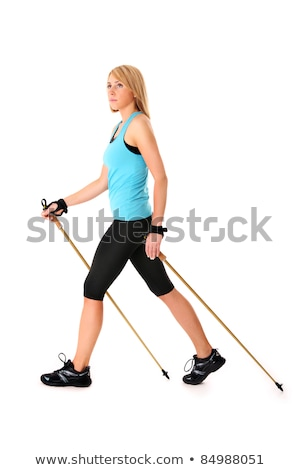 young woman practising nordic walking Stock photo © egrafika