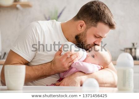Man Bottle Feeding Baby Stock fotó © O_Lypa