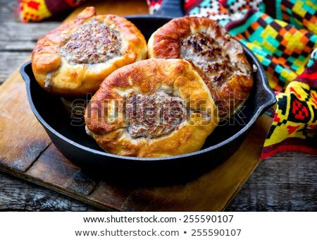 belyash ,yeast dough round pasty with meat filling . Stock photo © zoryanchik