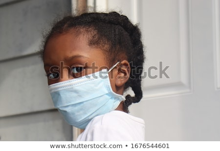 portrait of a beautiful black girl with white mask stock photo © zurijeta