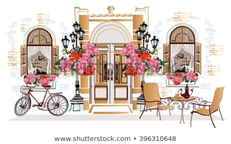 table with flower in street cafe stock photo © artjazz