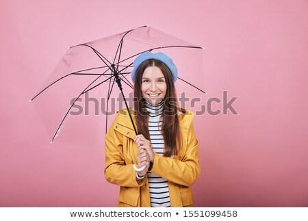 Close up portrait of smiling woman with blue umbrella against white background Stock photo © wavebreak_media