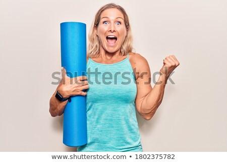 Sporty blonde holding exercise mat Stock photo © wavebreak_media