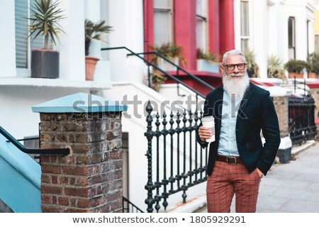 businessman with coffee to go, happy Stock photo © IS2