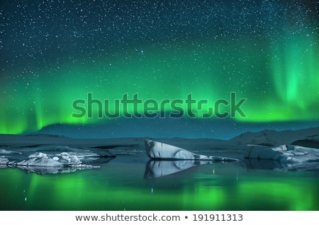 dramatic northern lights aurora in norway stock photo © solarseven