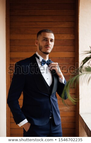 portrait of young businessman in black suit and bowtie Stock photo © feedough