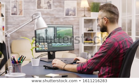 Woman and man working on a video in post-production Stock photo © Kzenon