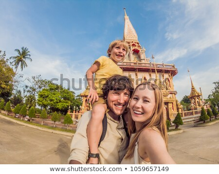 happy tourists mom and son in pagoda travel to asia concept traveling with a baby concept stock photo © galitskaya