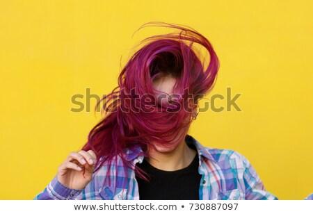 Positivity fashionable brunette in striped dress posing at street. Stock photo © studiolucky