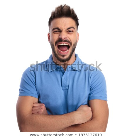 Angry young man wearing a light blue polo shouting out loud Stock photo © feedough