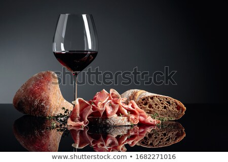 Wine glass and spanish jamon plate Stok fotoğraf © karandaev