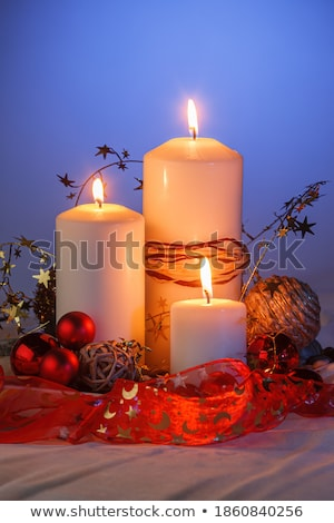 christmas decorations with three burning candles stock photo © robuart