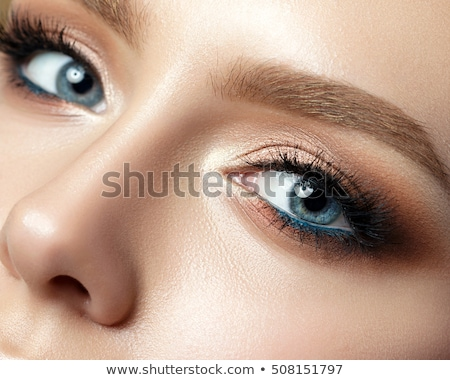 Close up of blue woman eye with beautiful brown with shades smokey eyes makeup. Modern fashion make  Stock photo © serdechny