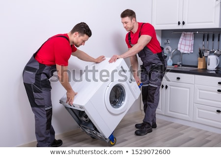 Two Movers Moving Appliance Stock photo © AndreyPopov