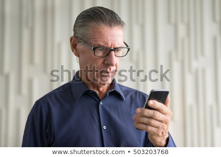 Stock photo: Businessman shocked by text message