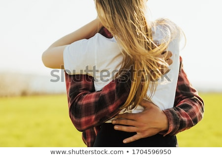 blonde woman hugged tenderly from the back by her partner Stock photo © photography33