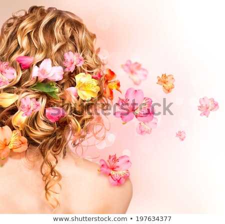 Schöne Frau lange lockiges Haar Stil rosa Blume Stock foto © Victoria_Andreas
