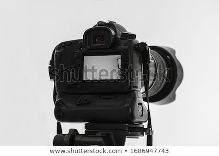 Single-lens reflex camera on tripod isolated on white Stock photo © monticelllo