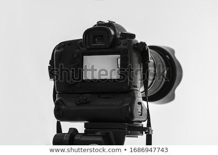 single lens reflex camera on tripod isolated on white stock photo © monticelllo