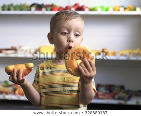 little boy eating toy Stock photo © chesterf
