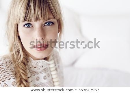 Belle jeunes dame blond cheveux yeux bleus Photo stock © Elmiko