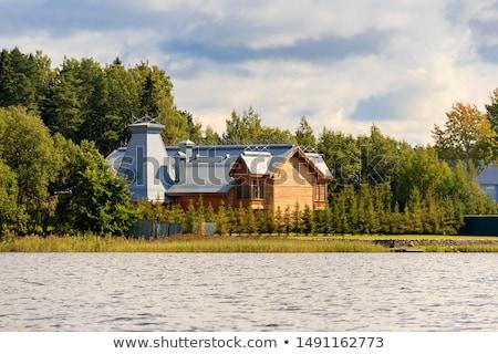 Rural house near river in beautiful landscape Stock photo © Nejron